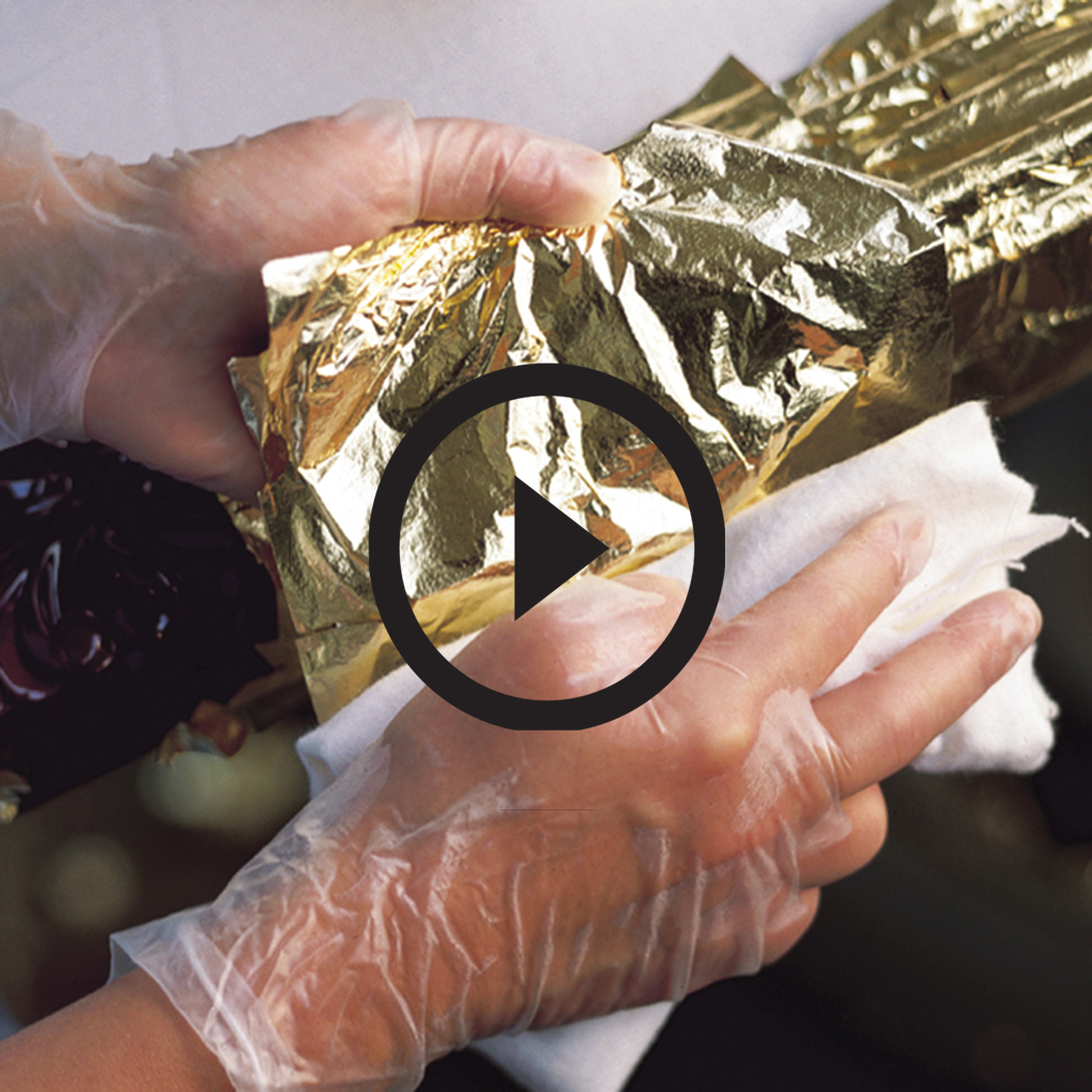 Applying gold by hand